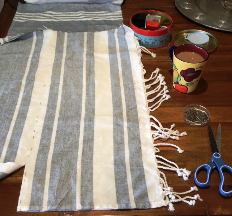 This unused beach towel is being repurposed into bread bags.