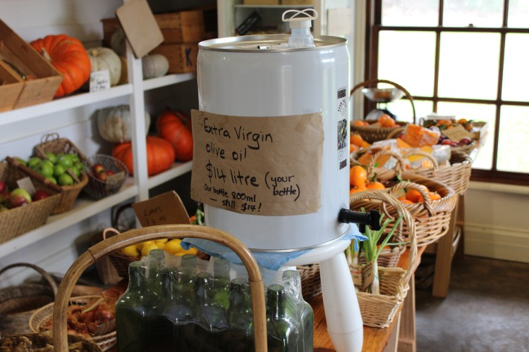I take my own bottle to refill with olive oil at Grow Lightly, Korumburra.