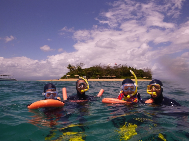 My family snorkelling at the Great Barrier Reef, Australia,