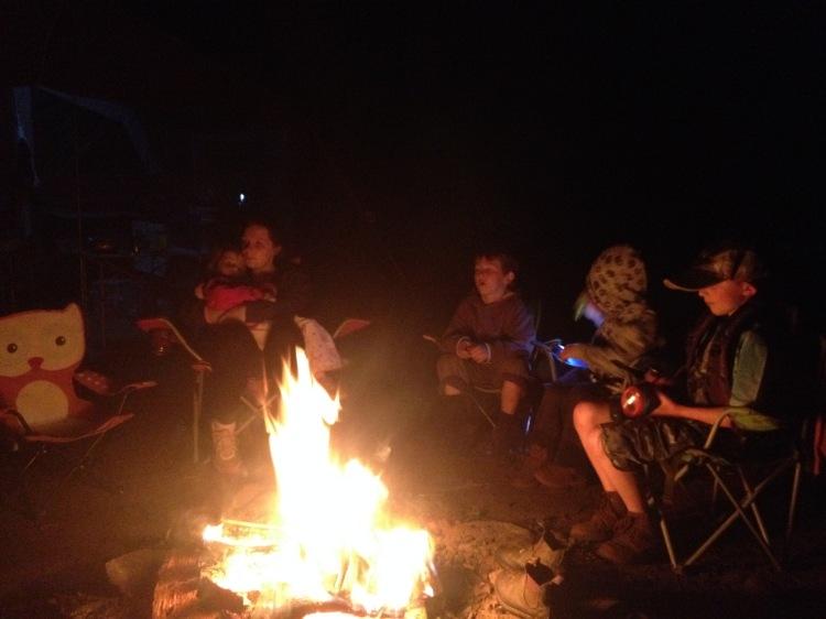 Kids around the campfire.