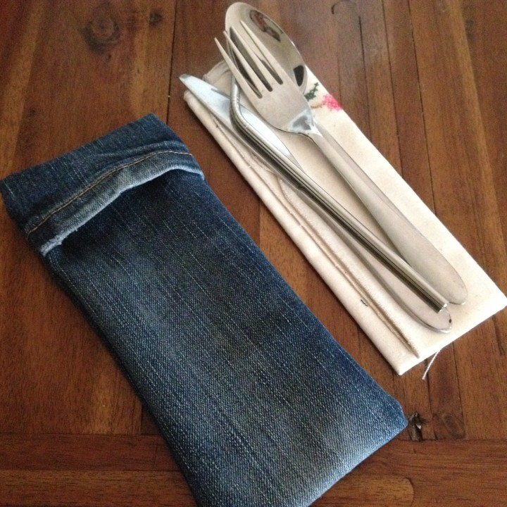 Finished denim cutlery pouch with reusable napkin, straw and cutlery.