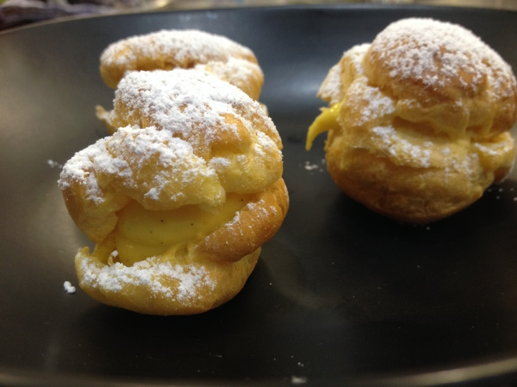 Profiteroles made with choux pastry and crème patissiere.
