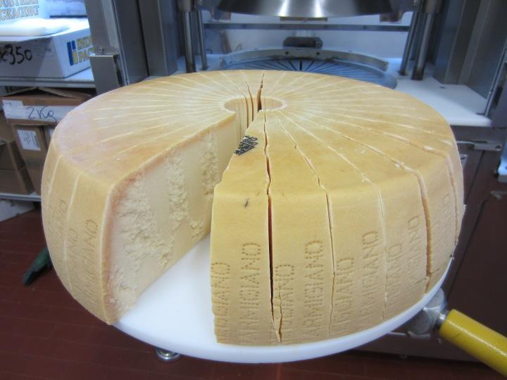 40kg wheel of plastic free parmesan split into wedges.