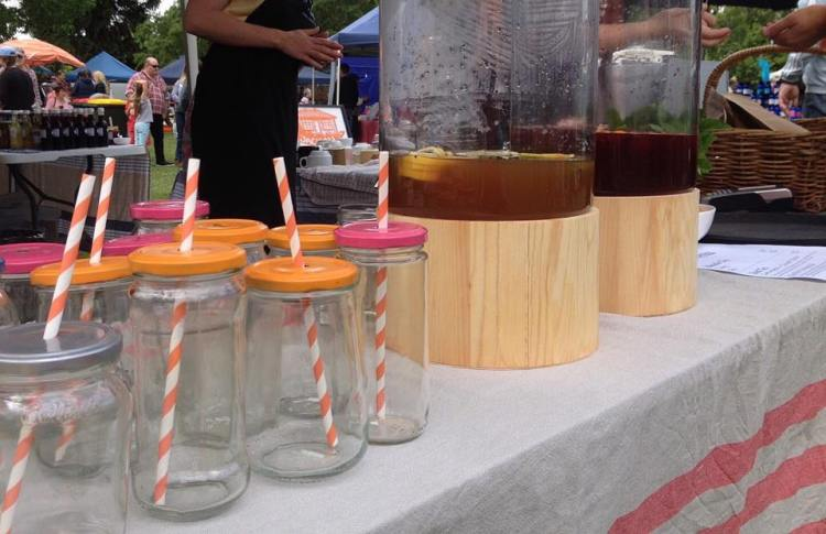 Jars reused for cold drinks with paper straws.
