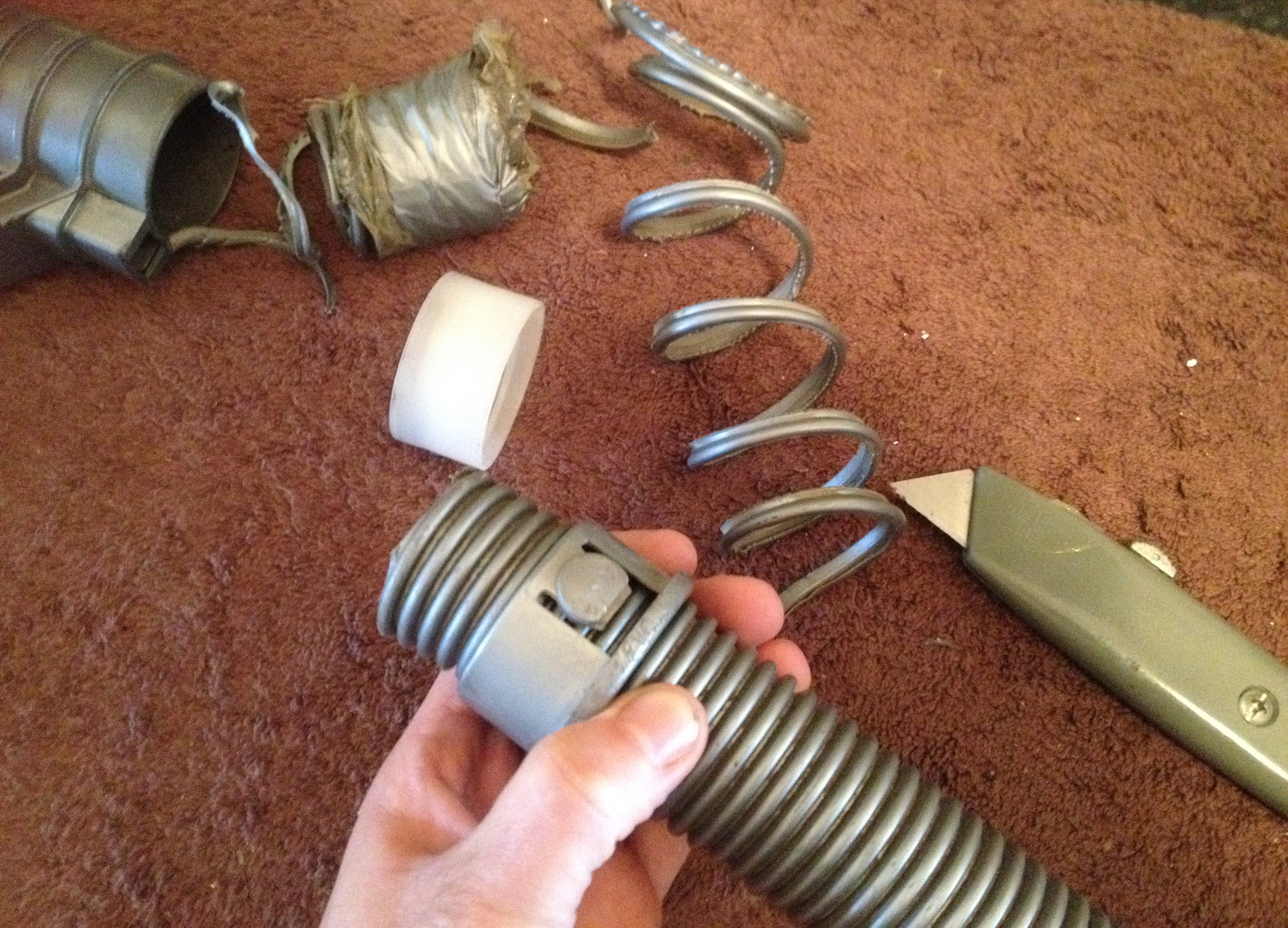 Repairing my split vacuum cleaner hose.