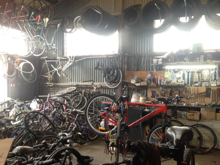 All the secondhand bicycles in the workshop at Re:cycle.
