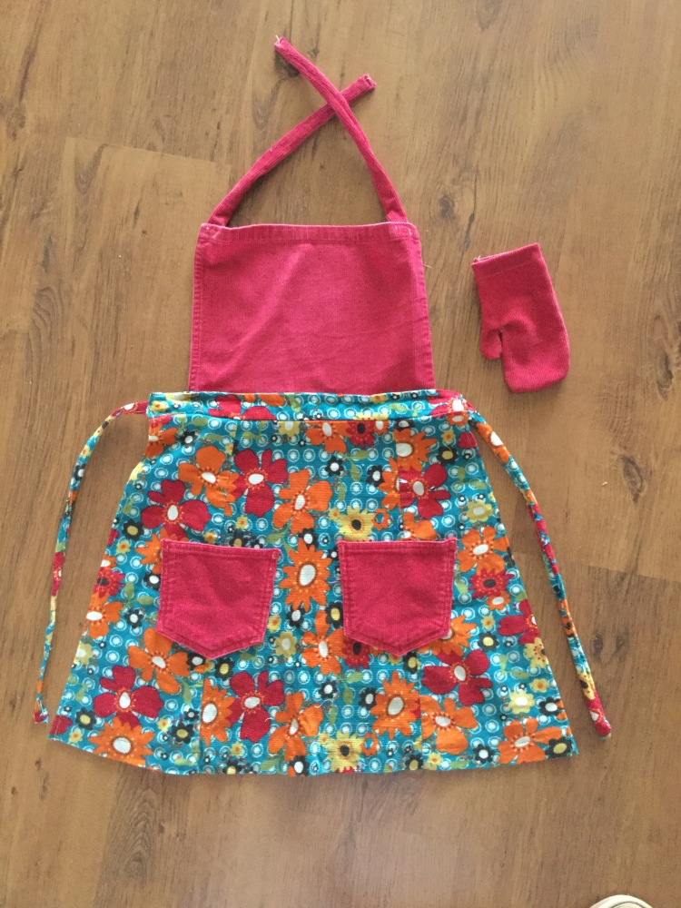Childrens apron and oven mitt handmade from upcycled materials.