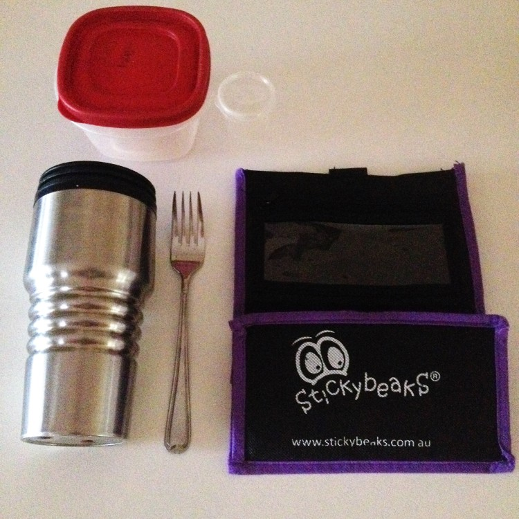 Reusable lunch order ttols for waste free lunches. Includes a reusable bag, travel mug, fork and small plastic tubs.