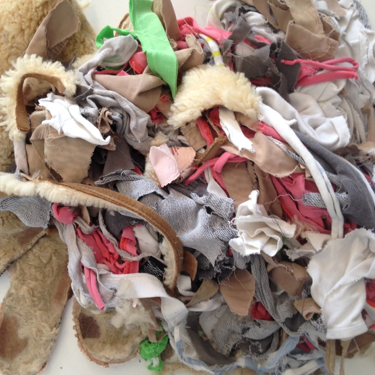 Fabric from clothing ready to be composted.