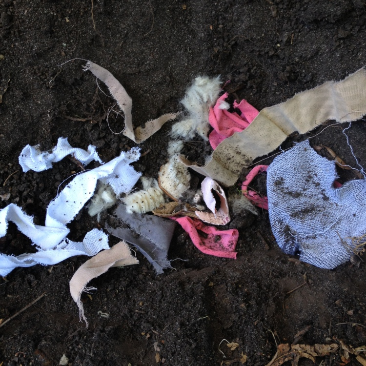 Burying clothing fabric in the compost heap or garden soil to biodegrade.