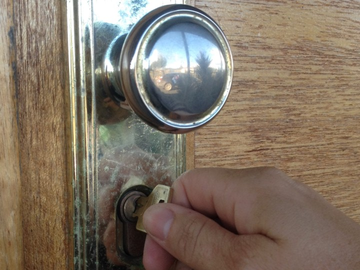 Unlocking door to new home.