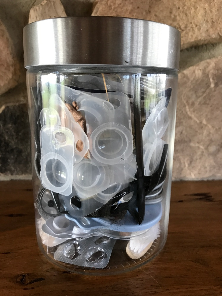 Contact lenses and blister packs in waste jar.