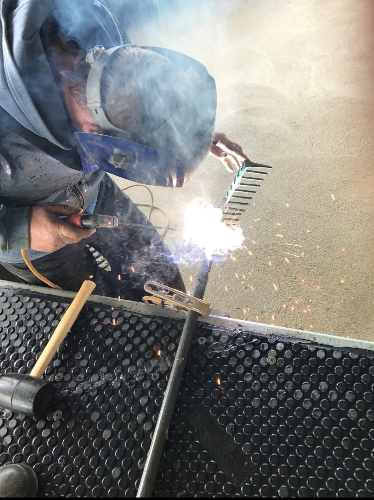 Welding a steel handle onto my garden rake.