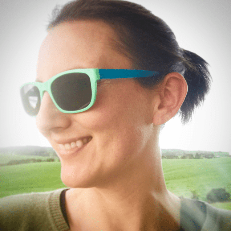 Tammy Logan from Gippsland Unwrapped wearing her Dresden sunglasses made from recycled milk bottle tops and beer keg caps.