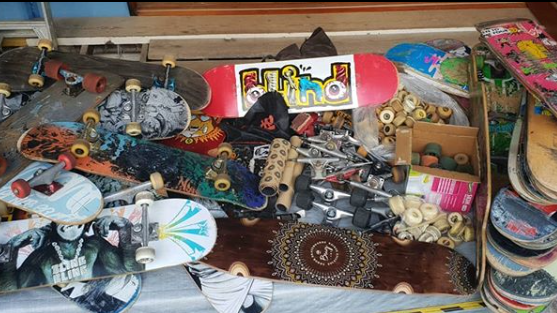 A jumble of skateboards and gear ready to head to the indigenous youth of the Northern Territory. 30 complete boards along with an extra 30 sets of trucks, 50 blank decks 486 wheels, bags and bags of bearings and other stuff that skateboarders love!