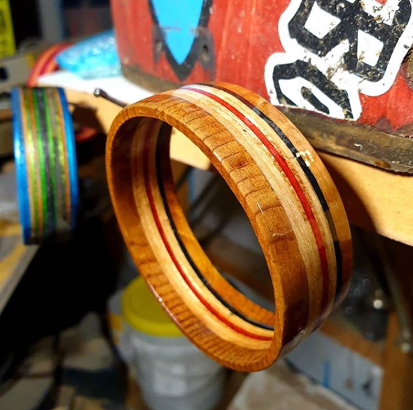 A bangle made from upcycled broken skateboards hanging on a nail in The Hairy Handyman's workshop.