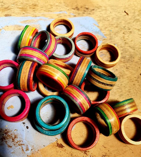 A jumble of rings made from upcycled broken skateboards on a bench in The Hairy Handyman's workshop.